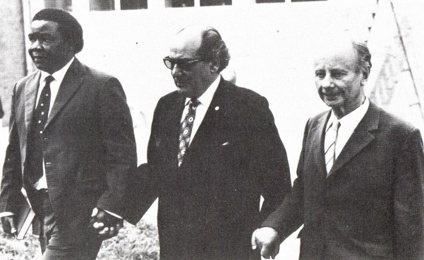 Hand of the Cause, Abu'l-Qásim Faizí walking with Enoch Olinga and Dr. Adelbert Mühlschlegel